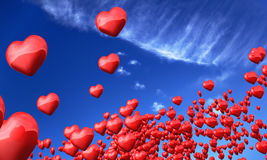 Heart shaped balloons in sky Royalty Free Stock Image