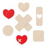 Heart shaped bandages Stock Photos
