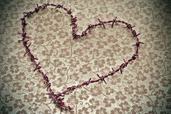 Heart-shaped barbed wire Stock Photo