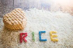 Heart-shaped basket and clothes peg Arrange the words. Heart-shaped basket and Colorful clothes peg Arrange the words RICE on rice background royalty free stock photos