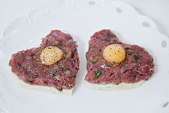 Heart shaped beef tartare. With egg Stock Photography