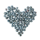 Heart shaped Bilberry or blueberry composition over isolated white background Stock Photography