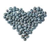 Heart shaped Bilberry or blueberry composition over isolated white background Royalty Free Stock Images