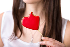 Heart shaped biscuit with bite Royalty Free Stock Photo