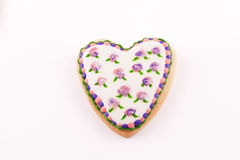 Heart-shaped biscuit with flowers drawn Royalty Free Stock Photo
