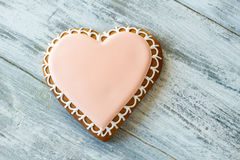 Heart shaped biscuit with icing. Stock Photos