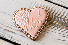 Heart shaped biscuit with inscription. Royalty Free Stock Photo