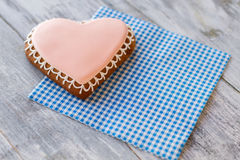 Heart-shaped biscuit on napkin. Royalty Free Stock Photo