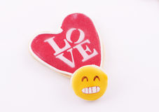 Heart-shaped biscuit with the word Love written Royalty Free Stock Image