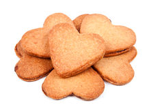 Heart shaped biscuits filled with marmelade. A pile of heart shaped biscuits filled with marmelade isolated on white background Royalty Free Stock Photo