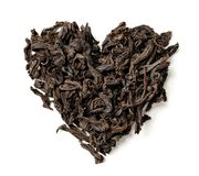 Heart shaped from black leaf tea isolated on white background. stock photo
