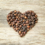 Heart shaped black pepper Royalty Free Stock Photos