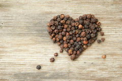 Heart shaped black pepper Stock Image