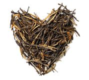 Heart shaped from black tea isolated on white background. Top view. Close up. High resolution Royalty Free Stock Image