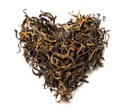 Heart shaped from black tea isolated on white background. Top view. Close up. High resolution Royalty Free Stock Photos