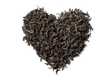 Heart shaped from black tea isolated on white background stock image