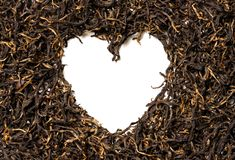 Heart shaped from black tea on white background. Top view. Close up. High resolution Stock Photography