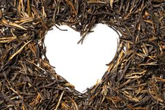 Heart shaped from black tea on white background. Top view. Close up. High resolution Stock Photo