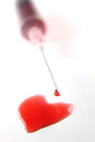 Heart shaped blood drops Royalty Free Stock Photo