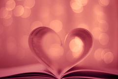 Heart shaped book on bokeh background. Blurred Heart Shaped Book opening Royalty Free Stock Images
