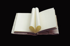 Heart Shaped Book isolated on black background. Stock Photos