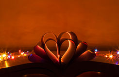 Heart Shaped Book. Opened book with heart shaped pages with back lit using serial lights Stock Photography