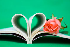 Heart shaped book and rose Stock Image