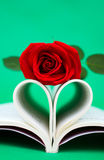 Heart shaped book and rose Stock Photos