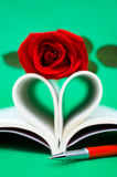 Heart shaped book and rose Stock Images