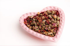 Heart Shaped Bowl (01). Heart shaped dish filled with rose buds Stock Photos
