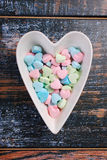 Heart shaped bowl with colorful sugar candies for valentines Stock Photos