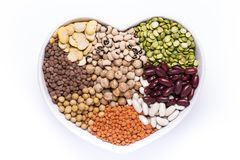 Heart-shaped Bowl Full Of Types Of Dry Legumes Stock Image