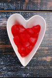 Heart shaped bowl with red candies for valentines Stock Photos