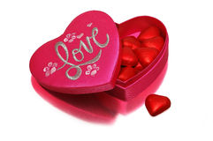 A heart-shaped box. Pink heart-shaped box with sweets stock photo