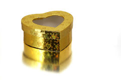 A heart-shaped box. Golden heart-shaped box stock photos