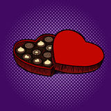 Heart shaped box with chocolate candies pop art Stock Photography