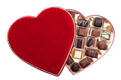 Heart Shaped Box of Chocolates. Red velvet, heart shaped box of chocolates.  Shot on white background Royalty Free Stock Image