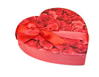 Heart shaped box of chocolates with red roses Royalty Free Stock Images