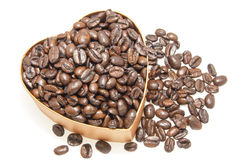 Heart Shaped Box with Coffee Beans. Heart Shaped Gift box Overflowing with Roasted Coffee Beans Isolated on White Background Stock Photos