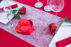 Heart-shaped box on decorated table Royalty Free Stock Image
