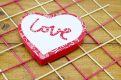 Heart shaped box on a decorated table. Heart shaped box decorated on a wooden table Stock Photography