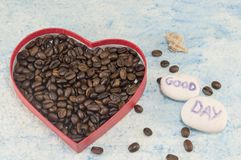 Heart shaped box filled with coffee beans Royalty Free Stock Image