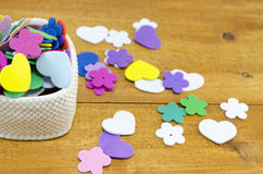 Heart shaped box filled with colorful paper hearts and flowers Stock Photos