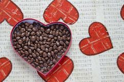 Heart shaped box filled with small chocolates balls Stock Image