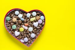 Heart shaped box filled with small chocolates balls Stock Photo