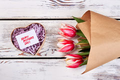 Heart-shaped box and flowers. Stock Photography