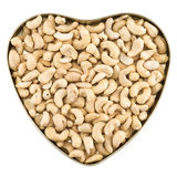 Heart shaped box full of peanuts. Heart shaped box full of peanut nuts isolated over white background, top view Stock Photography