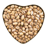 Heart shaped box full of pistachio. Nuts isolated over white background, top view Stock Photo