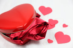 Heart shaped box with a gift Stock Photography