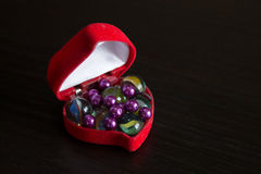 Heart shaped box with pearls Stock Photos
